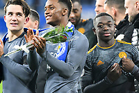 Football - 2018 / 2019 Premier League - Cardiff City vs. Leicester City<br /> <br /> Demarai Gray  of Leicester City with rose tribute from a fan to Vichai Srivaddhanaprabha after the game in Leicster's 1st match since the death of Vichai Srivaddhanaprabha, at Cardiff City Stadium.<br /> <br /> COLORSPORT/WINSTON BYNORTH