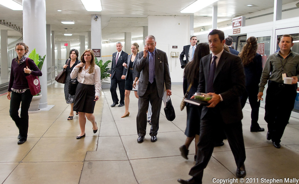 Senator Chuck Grassley (R-IA) talks on his cell phone after taking the Capitol Subway before a vote in the United States Capitol building in Washington, D.C. on Thursday, June 23, 2011.