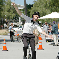 Mark Wenzel rides a unicycle during Santa Monica Public Library's bicycles and cycling iCycle festival on Saturday, May 22, 2010.