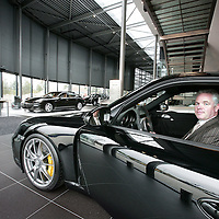 Nederland, Amsterdam , 15 september 2009..Ron Loenen in zijn nieuwe showroom van Porsche..Foto:Jean-Pierre Jans.Ron Loenen in his new Porsche showroom.