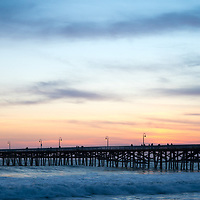 Orange County pier San Clemente California sunset panorama photo. San Clemente is a coastal city along the Pacific Ocean in the Western USA. Panoramic photo ratio is 1:3. Copyright ⓒ 2017 Paul Velgos with all rights reserved.