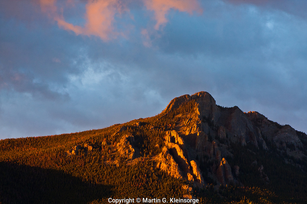 Sunrise over the Crags on the north side of Twin Sisters Peak.  Rocky Mountain National Park, Colorado, USA.