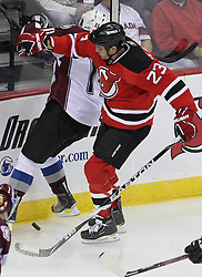 Oct 15; Newark, NJ, USA; New Jersey Devils center David Clarkson (23) hits Colorado Avalanche center Philippe Dupuis (11) during the third period at the Prudential Center. The Avalanche defeated the Devils 3-2.