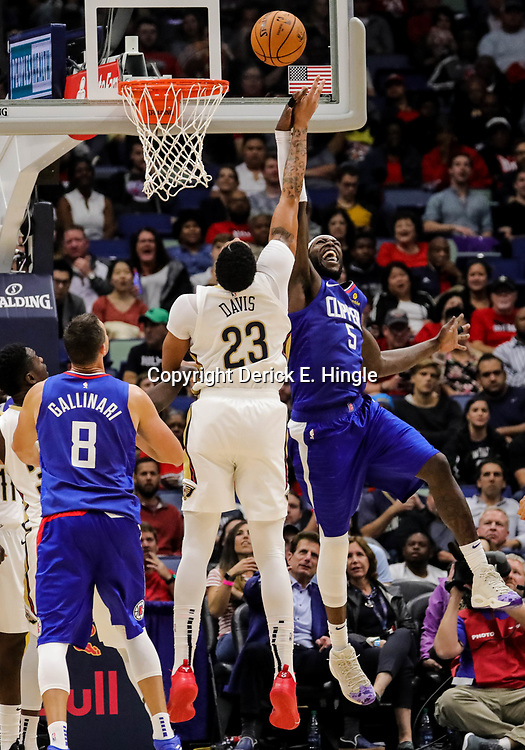 Oct 23, 2018; New Orleans, LA, USA; Los Angeles Clippers forward Montrezl Harrell (5) blocks a shot by New Orleans Pelicans forward Anthony Davis (23) during the second quarter at the Smoothie King Center. Mandatory Credit: Derick E. Hingle-USA TODAY Sports