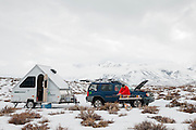 Scott waxing skis off his car battery at his camp near the hot springs in Owens Valley during the recent Mammoth Super G series races at Mammoth Mountain.