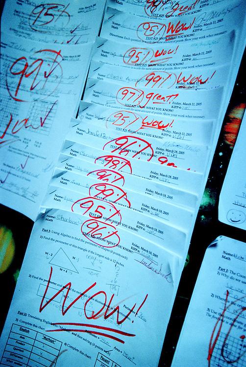 USA, New York, Bronx, 23 May 2005.The KIPP - Knowledge Is Power Program - is a network of schools in under-resourced communities in the United States. The schools are public but kids have to agree to spend 10 hours a day at school six days a week, and to keep to a high discipline. The KIPP was started by two motivated teachers and has proven to be extremely successful with a lot of students continuing on to college..The KIPP Academy in The Bronx ranks in the top 10% of all New York City Public Schools. It also has an orchestra where all the students play..Good test scores are exhibited in the hallways, as an encouragement and example to others.<br /> <br /> <br /> Etats-Unis, New York, Bronx, 23 mai 2005.Le KIPP (Knowledge is Power Program, en franc?ais, Programme Le Savoir est le Pouvoir), est un re?seau d'e?coles destine?es aux communaute?s de?favorise?es des Etats-Unis. Les e?coles sont publiques mais les enfants doivent accepter de venir a? l'e?cole 10 heures par jour six jours par semaine et se conformer a? une discipline stricte. Le KIPP a e?te? cre?e? par deux enseignants motive?s et a beaucoup de succe?s, une grande partie des e?le?ves poursuivant des e?tudes supe?rieures..La KIPP Academy du Bronx fait partie des 10% d'e?coles les plus co?te?es parmi les e?coles publiques de New York. Les e?le?ves font tous partie de l'orchestre de l'e?cole..Les bonnes notes sont expose?es dans le couloir pour encourager les e?le?ves et leur donner l'exemple...&copy; Chris Maluszynski /MOMENT