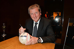 On 25th April 2014 in London at the Hublot Boutique in New Bond Street, Ricardo Guadalupe, CEO of Hublot, presented Roy Hodgson, the Manager of the England National football team, with a watch that has been created and named in his honour. The Hublot King Power 66 Hodgson is a Limited Edition of 66 pieces to commemorate the year that England won the World Cup. The idea was hatched from Roy's son Christopher who also collaborated with Hublot on the design of this amazing piece. The presentation was followed by a tour and a dinner at the House of Commons that was attended by Hublot VIP customers.<br /> <br /> PICTURE SHOWS:- Roy Hodgson, the Manager of the England National football team signing mini footballs.