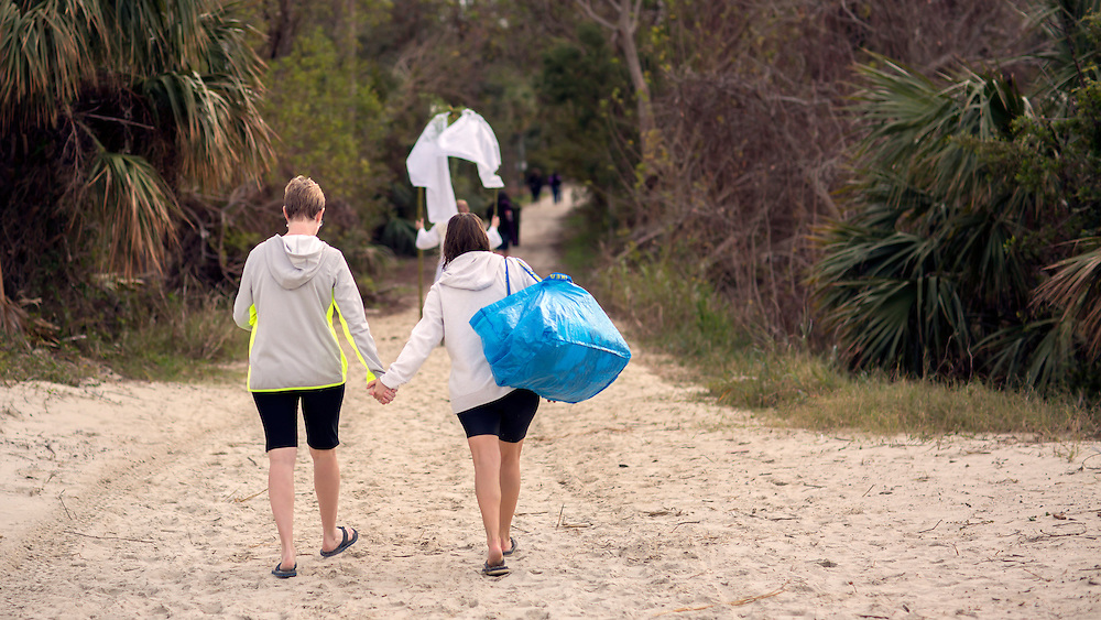 TYBEE ISLAND, GA - JAN., 1, 2017: Haley Hill and Christina Pomroy take the plunge at the beach, Sunday, January 1, 2017, in Tybee Island, Ga. (Photo by Stephen B. Morton)