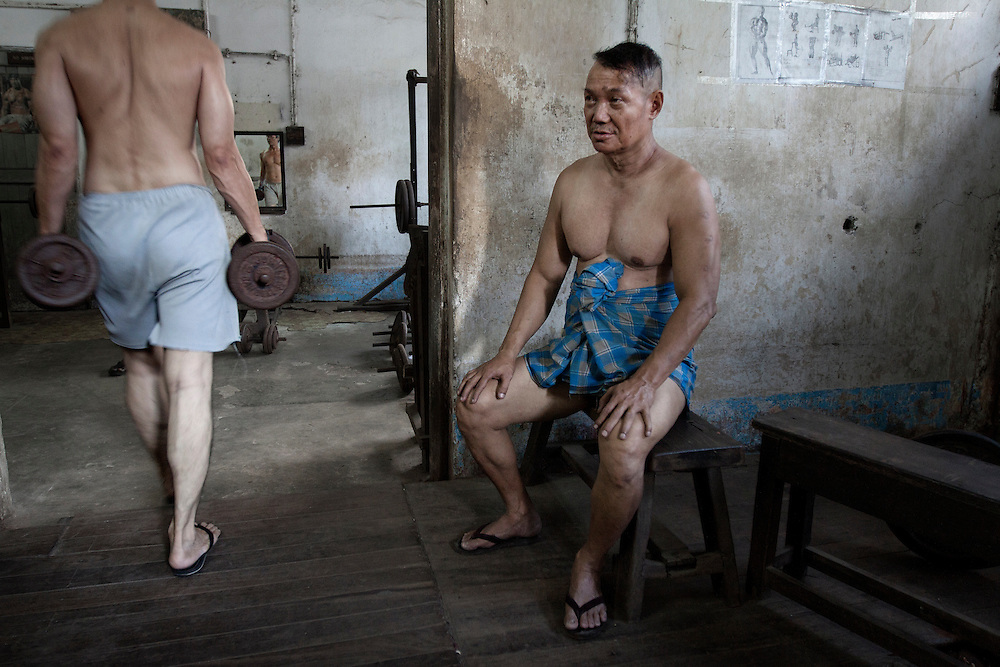 Men of all ages work out and practice lethwei - the Burmese kick boxing -  at the gym of YMCA in Yangon, Myanmar.
