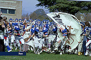 Members of the Liberty Baptist College (LBC) Flames Football team take the field at Lynchburg Municipal Stadium in November of 1979.