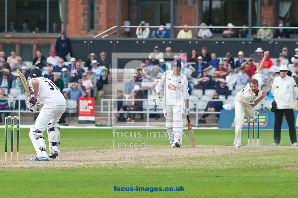 Tom Smith of Lancashire County Cricket Club bowls to Luke Wells of Sussex County Cricket Club during the LV County Championship Div One match at Old Trafford Cricket Ground, Stretford<br /> Picture by Ian Wadkins/Focus Images Ltd +44 7877 568959<br /> 06/05/2014