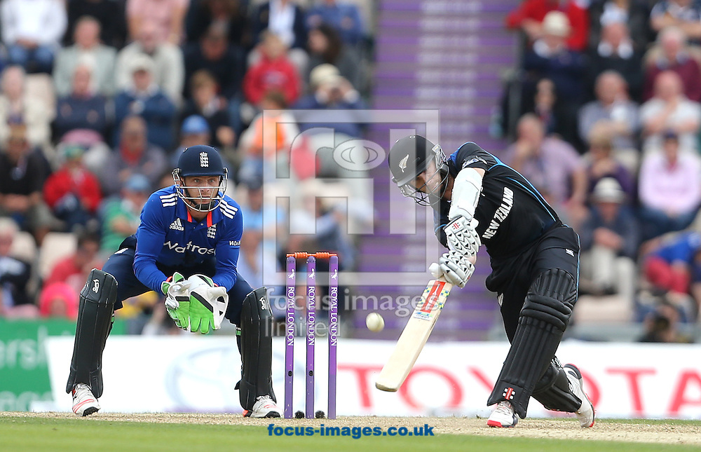 Kane Williamson ( R ) of New Zealand plays a shot ahead of Jos Butler of England during the Royal London One Day Series match at the Ageas Bowl, West End<br /> Picture by Paul Terry/Focus Images Ltd +44 7545 642257<br /> 14/06/2015