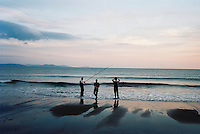 Fishermen at dusk on the Dingle peninsula, Kerry, Ireland. 2009
