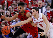 Maryland's Melo Trimble, left, and Wisconsin's Zak Showalter (3) go after a loose ball. (AP Photo/Andy Manis)