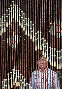 A waitress is seen behind a screen at Paomo, a restaurant specializing in food from Shanxi province in Beijing, China.