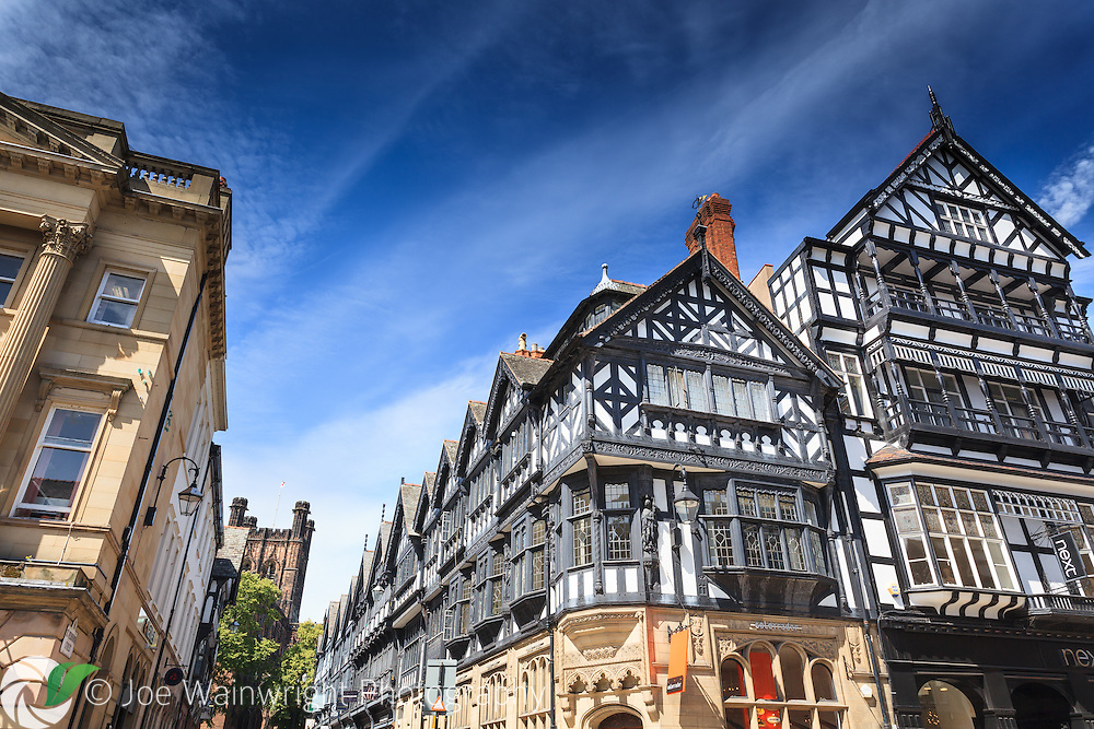 Chester - pictured are 21st century shops, in Victorian properties, designed  to emulate Tudor architecture and a street leading to a Norman cathedral.