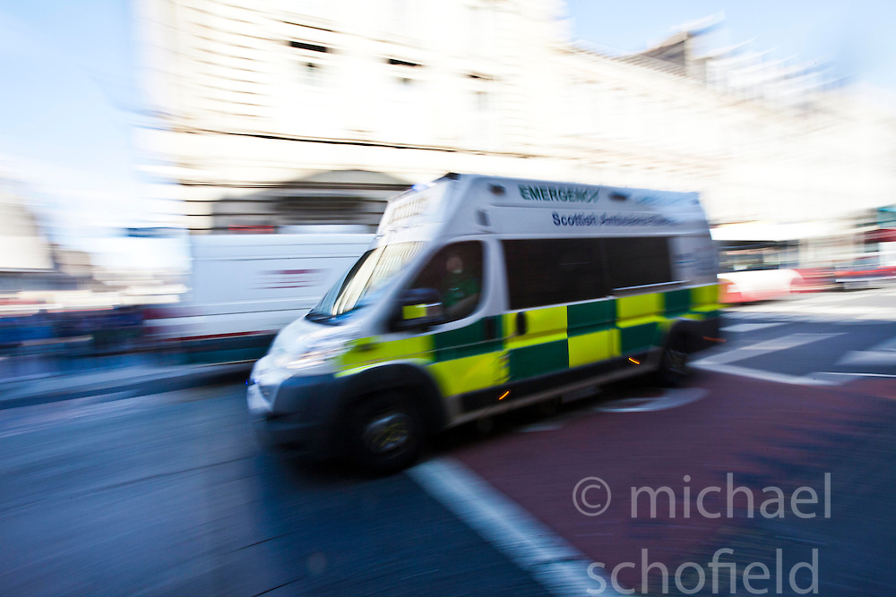 Ambulance passing the corner of High Street and North Bridge Street in Edinburgh..©Michael Schofield
