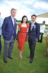 Left to right, ARNAUD BAMBERGER, DITA VON TEESE and FRANCOIS LE TROQUER at the Cartier Queen's Cup Polo Final, Guards Polo Club, Windsor Great Park, Berkshire, on 17th June 2012.