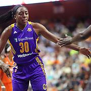 UNCASVILLE, CONNECTICUT- JULY 15: Nneka Ogwumike #30 of the Los Angeles Sparks encourages a team mate during the Los Angeles Sparks Vs Connecticut Sun, WNBA regular season game at Mohegan Sun Arena on July 15, 2016 in Uncasville, Connecticut. (Photo by Tim Clayton/Corbis via Getty Images)