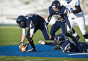 Duchesne free safety McKade Nielsen (31) picks up a Rich fumble and returns it for a touchdown during the Utah High School 1A Football championship game between Duchesne and Rich in Pleasant Grove, Saturday, Nov. 10, 2012.