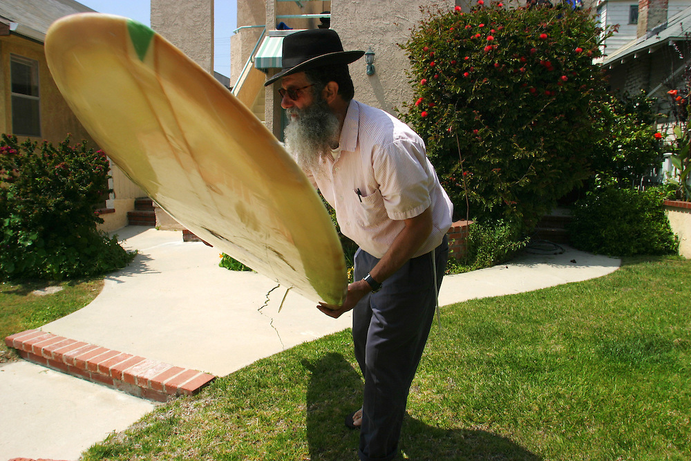 Rabbi Nachum Shifren, 54, prepares to go surfing in Venice Beach, CA., on Sunday, April 30, 2006. Born in to a Jewish Family in Los Angeles, CA., Shifren was not a religious person when he began surfing at the age of 12. At the age of 33, Shifren began to follow the Jewish tradition and practice Kabala, and since then has been know as ?The Surfing Rabbi.?  Today, Shifren lives in Venice Beach, CA., and teaches surfing and kabala to students around the world.