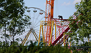 A worker assembles part of the Crazymouse Rollercoaster at Red River Exhibition Park prior to the Ex, which will be here June 13-22, Saturday, June 7, 2014. (TREVOR HAGAN/WINNIPEG FREE PRESS)