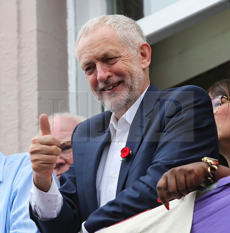 © Licensed to London News Pictures. 09/07/2016. Durham, UK. Labour leader Jeremy Corbyn gives the thumbs up to supporters at the Durham Miners' Gala in County Durham, UK. The gala is a large gathering held annually associated with the coal mining heritage and trade unionism. Photo credit : Ian Hinchliffe/LNP