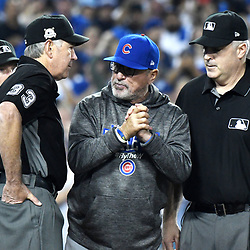 Chicago Cubs manager Joe Maddon, right, argues with Umpire Mike Winters (33) after being ejected from the game after a play at home plate was over turned as Los Angeles Dodgers Charlie Culberson (not pictured) was called safe after a review of the call at home plate in the sixth inning of a National League Championship Series baseball game at Dodger Stadium on Saturday, Oct. 14, 2017 in Los Angeles. (Photo by Keith Birmingham, Pasadena Star-News/SCNG)
