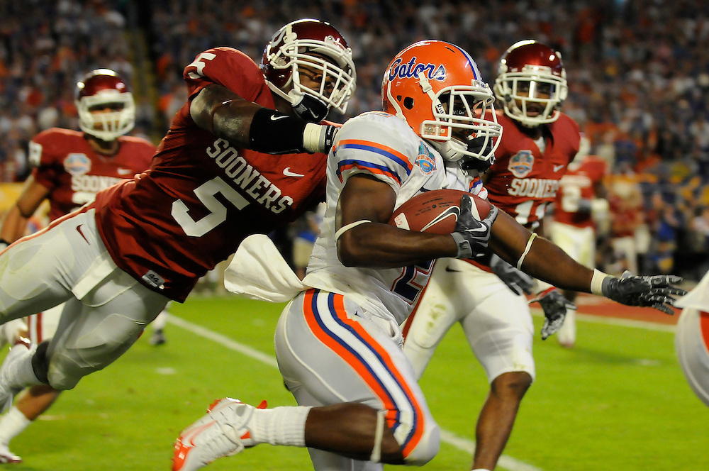 January 8, 2009: Brian Jackson of the Florida Gators runs past Nic Harris of the Oklahoma Sooners during the NCAA football game between the Florida Gators and the Oklahoma Sooners in the 2009 BCS National Championship Game. The Gators defeated the Sooners 24-14.