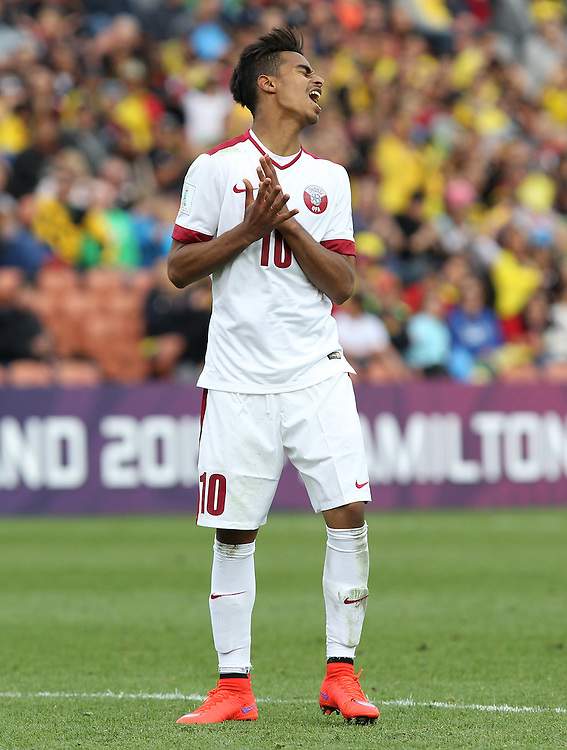 Akram Afif of Qatar reacts after missing a goal against Colombia in the group c game of the FIFA u20 World Cup at Waikato Stadium, Hamilton, New Zealand, Sunday, May 31, 2015. Credit:SNPA / Ben Campbell