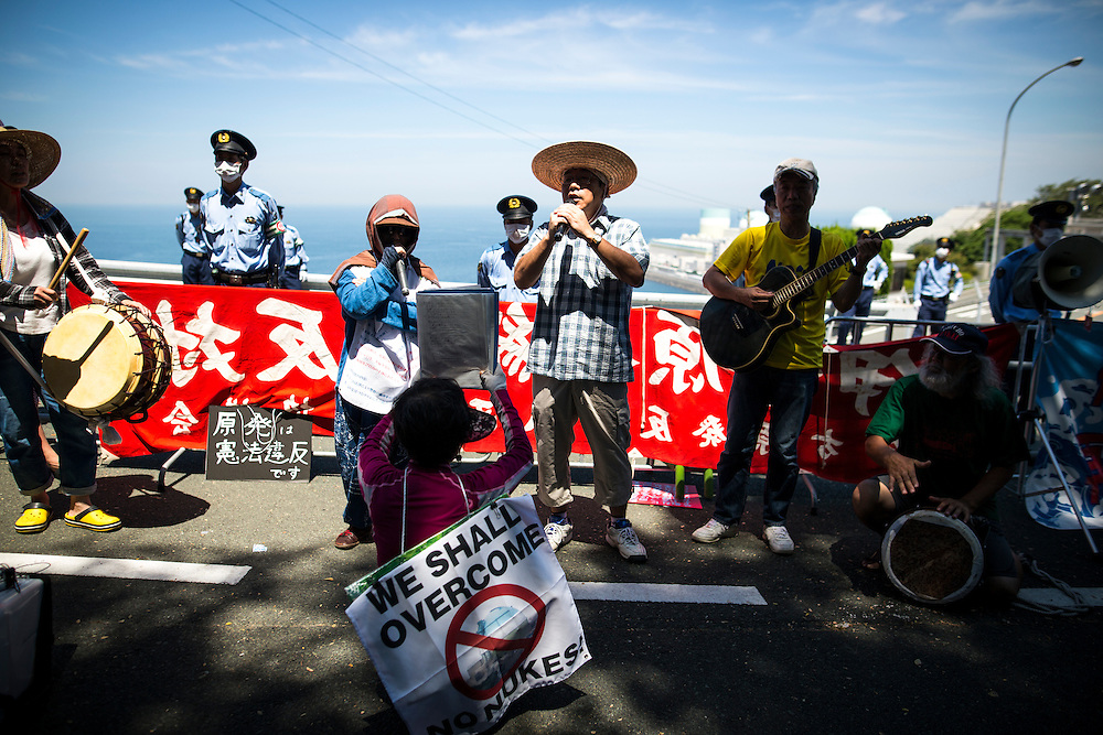 EHIME, JAPAN - AUGUST 11 : Anti-nuclear protesters gather in front of Ikata Nuclear Power Plant to protest against the restarting of a nuclear reactor on August 11, 2016 in Ikata, Ehime prefecture, northwestern Shikoku, Japan. The No. 3 reactor of the nuclear plant is expected to resume operations this week after The Nuclear Regulation Authority (NRA's) has completed it's final inspections of the plant's operational safety measures. The plant has not generated nuclear power since Japan's 2011 nationwide shutdown of all nuclear plants in the aftermath of the Fukushima Daiichi nuclear disaster. Ikata Nuclear Power Plant will be the third nuclear power plant in Japan to become operational. (Photo by Richard Atrero de Guzman/NURPhoto)