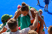 Elena Tice of Ireland (12) celebrates with friends in the crowd after  the Vitality Hockey Women's World Cup 2018 Semi-Final match between Ireland and Spain at the Lee Valley Hockey and Tennis Centre, QE Olympic Park, United Kingdom on 4 August 2018. Picture by Martin Cole.