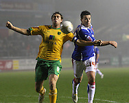 Carlisle - Saturday November 28th, 2009 :Ian Harte of Carlisle United and Grant Holt of Norwich City during the FA Cup second round match at Brunton Park, Carlisle. (Pic by Andrew Stunell/Focus Images)..