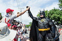 "BAR HARBOR, MAINE, July 4, 2014. ""Bar Harbor Batman"" give a high-five to a spectator at the Independence Day Parade"