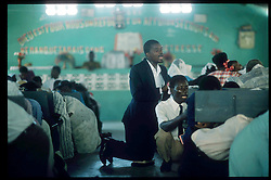 CAP HAITIEN, HAITI - Church is one of the few places the people of Cap Haitien can find peace. (PHOTO © JOCK FISTICK)....