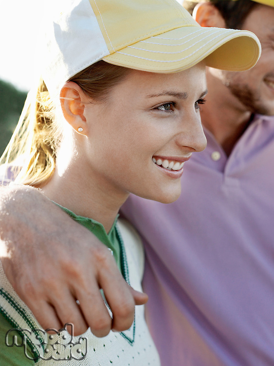 Two young golfers on court focus on smiling woman
