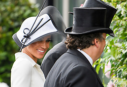 © Licensed to London News Pictures. 19/06/2018. London, UK.  Meghan, Duchess of Sussex attends Day one of Royal Ascot at Ascot racecourse in Berkshire, on June 19, 2018. The 5 day showcase event, which is one of the highlights of the racing calendar, has been held at the famous Berkshire course since 1711 and tradition is a hallmark of the meeting. Top hats and tails remain compulsory in parts of the course. Photo credit: Ben Cawthra/LNP