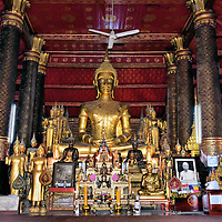 Gilded Buddha at Altar at Wat Mai in Luang Prabang, Laos<br />