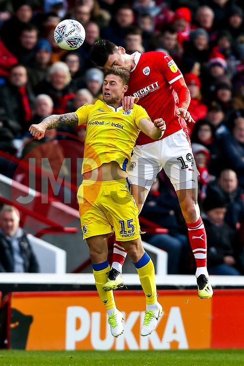 James Clarke of Bristol Rovers challenges Kieffer Moore of Barnsley - Mandatory by-line: Robbie Stephenson/JMP - 27/10/2018 - FOOTBALL - Oakwell Stadium - Barnsley, England - Barnsley v Bristol Rovers - Sky Bet League One