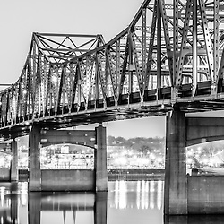 Peoria Illinois Bridge at Night Panorama Photo in black and white. The Murray Baker Bridge spans the Illinois River connecting Peoria with East Peoria as Interstate I-74. Built in 1958, the bridge is named after Murray Baker who started a company that would later become Caterpillar. Panorama photo ratio is 1:3.