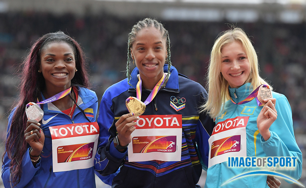 Aug 8, 2017; London, United Kingdom; Women's triple jump medalists pose during the IAAF World Championships in Athletics at London Stadium at Queen Elizabeth Park. From left: silver medalist Caterine Ibarguen (COL), gold medalist Yulimar Rojas (VEN) and bronze medalist Olga Rypakova (KAZ).