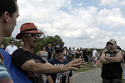 Scott Hancock, college professor from Gettysburg, goes in discussion with patriotic activists a Confederate flag rally, at the historic Gettysburg battleground, in Gettysburg, Pennsylvania, on the 154th anniversary of the Civil War battle, on July 1st, 2017.
