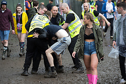© Licensed to London News Pictures . 12/06/2016 . Manchester , UK . Security detain a man at the Parklife music festival at Heaton Park in Manchester . Photo credit : Joel Goodman/LNP