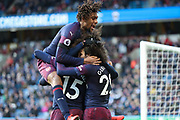 Arsenal forward Alexandre Lacazette (9) celebrates with Arsenal midfielder Matteo Guendouzi (29), Arsenal forward Alex Iwobi (17) and Arsenal midfielder Ainsley Maitland-Niles (15) after scoring his team's second goal during the Premier League match between Huddersfield Town and Arsenal at the John Smiths Stadium, Huddersfield, England on 9 February 2019.