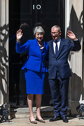 © Licensed to London News Pictures. 24/07/2019. London, UK. Prime Minister Theresa May (L) and her husband Philip May (R) wave as she leaves Downing Street. Boris Johnson will become the next Prime Minister this afternoon. Photo credit: Rob Pinney/LNP