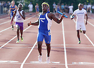 Monticello's Shane Jackson crosses the finish line first in the 1,600-meter relay during the Section 9 track and field state qualifier in Middletown on Friday, May 31, 2013.