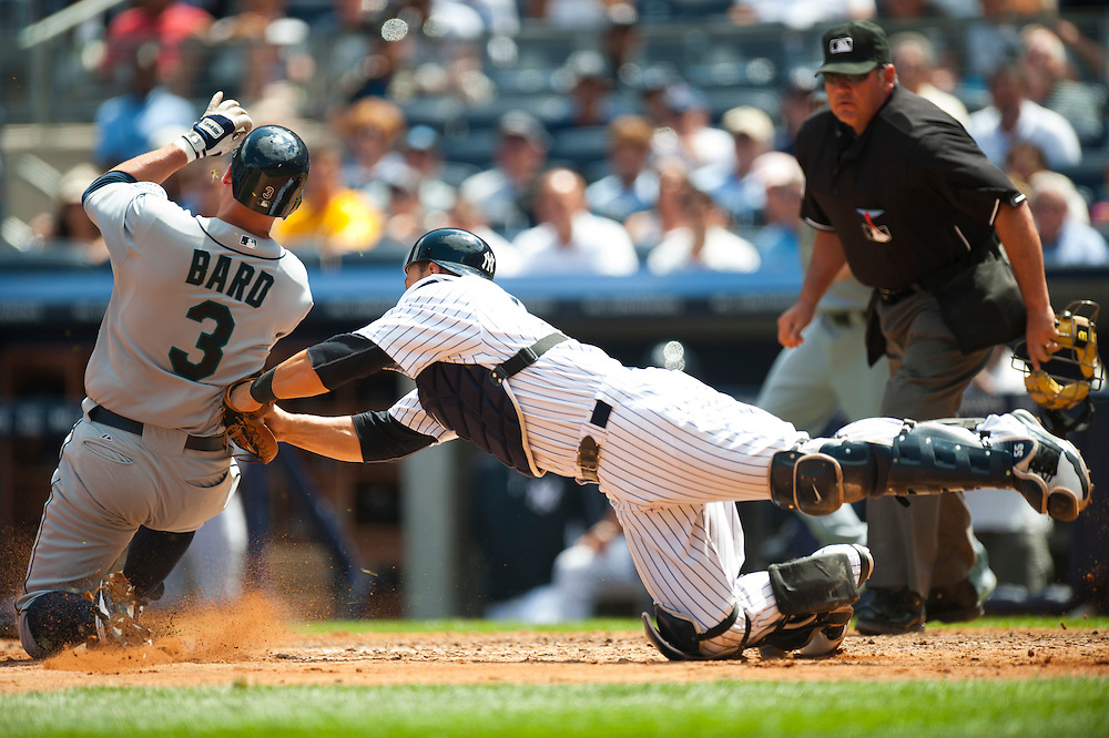 NEW YORK - JULY 27: Russell Martin #55 of the New York Yankees attempts to tag out Josh Bard #3 of the Seattle Mariners during the game against the Seattle Mariners at Yankee Stadium on July 27, 2011 in the Bronx borough of Manhattan. (Photo by Rob Tringali) *** Local Caption *** Russell Martin, Josh Bard