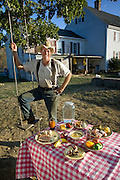 Joel Salatin, a farmer and author with his typical day's worth of food on his family farm in Virginia's Shenandoah Valley. (From the book What I Eat: Around the World in 80 Diets.) The caloric value of his day's worth of food on a day in the month of October was 3,900 kcals. He is 50 years old; 5 feet. 11 inches tall; and 198 pounds.  Much of his daily fare is from his own farm, including applesauce and apple cider canned by his wife, Teresa, who fills the basement larder with the bounty of their farm each year.  MODEL RELEASED.