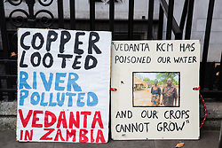 London, UK. 15th January, 2019. Signs brought by environmental campaigners from Foil Vedanta protesting outside the Supreme Court where British mining company Vedanta Resources is appealing High Court and Court of Appeal rulings that 1,826 Zambian villagers may have their case regarding pollution against the company's subsidiary Konkola Copper Mines (KCM) heard in the UK. The villagers contend that Konkola Copper Mines has polluted the River Kafue with excessive levels of copper, cobalt and manganese since 2004, causing sickness, deaths, damage to property and loss of income.