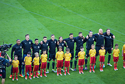 LYON, FRANCE - Wednesday, July 6, 2016: The Wales line up for the national anthem ahead of the UEFA Euro 2016 Championship Semi-Final match against Portugal at the Stade de Lyon. Captain Ashley Williams, Wales goalkeeper Wayne Hennessey, Neil Taylor, James Chester, Andy King, Joe Allen, Hal Robson-Kanu, Joe Ledley, Gareth Bale, James Collins, Chris Gunter. (Pic by Paul Greenwood/Propaganda)